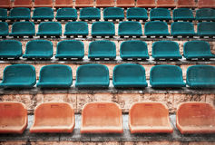 Empty old plastic seats at stadium, open door sports arena. Royalty Free Stock Image