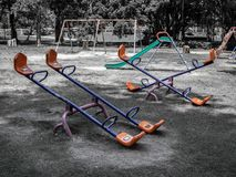 Empty old playground in public park royalty free stock photo