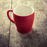 Empty old red coffee mug Stock Photography