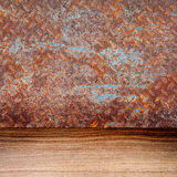 Empty old rusty metal plate and wooden floor Royalty Free Stock Images