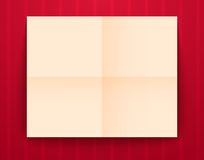 Empty old sheet of paper folded in fourfold on red Stock Photo
