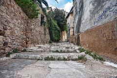 Empty old street. Empty street in old town with cracks on road royalty free stock images