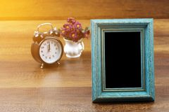 Empty of old style antique wooden photo frame and alarm clock wi Stock Photography