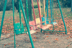 Empty old swing in motion. Royalty Free Stock Photography