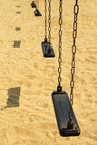 Empty old swing set Royalty Free Stock Images