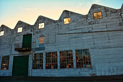 Empty old warehouse with broken glass refelctions Royalty Free Stock Photos