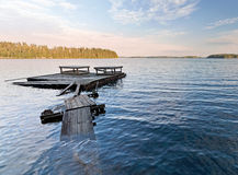 Empty old wet wooden pier Stock Image