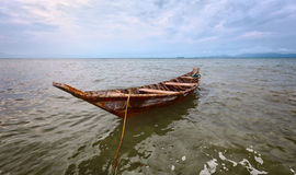 Empty old wooden boat on the waves Stock Image