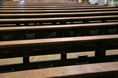 Empty old and wooden church pews without people. In bavaria royalty free stock image