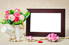 Empty old wooden photho frame with roses. Stock Images