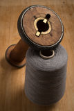 Empty Old Wooden Spool Beside Grey Thread Royalty Free Stock Image