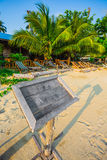 Empty old wooden Whiteboard (menu board) on a tropical beach Stock Photography