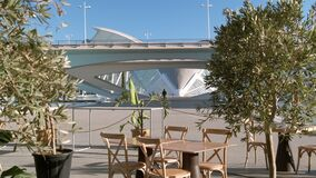 Empty open-air outdoor cafe in area of City of Arts. Spain