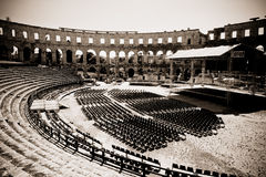 Empty open air stage at ancient roman amphitheate Royalty Free Stock Photography
