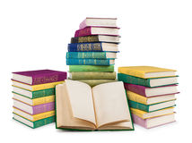 Empty open book and pile of colorful vintage books Stock Image