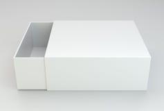 Empty open box on gray background. Royalty Free Stock Photos