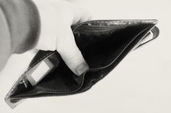 Empty open brown purse in one hand. Royalty Free Stock Photography