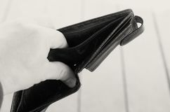 Empty open brown purse in one hand. Stock Images
