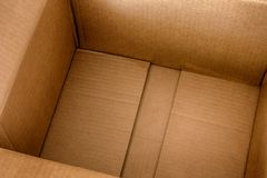 Empty open cardboard box Royalty Free Stock Images