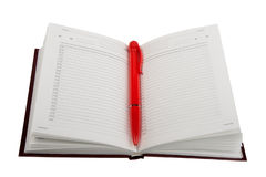 Empty open diary and red ball point pen. Royalty Free Stock Image