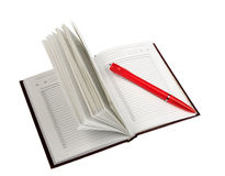 Empty open diary and red ball point pen Royalty Free Stock Images