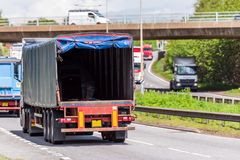 Empty open door lorry truck on uk motorway in fast motion.  royalty free stock photo