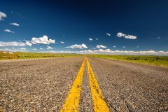 Empty open highway in Wyoming. USA Royalty Free Stock Photos
