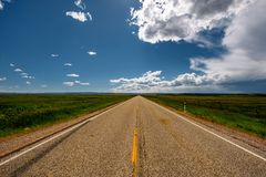 Empty open highway in Wyoming. USA Stock Photos