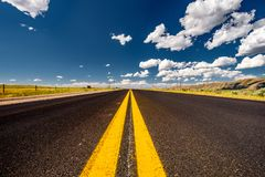 Empty open highway in Wyoming. USA Stock Images