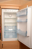 Empty open refrigerator Stock Images