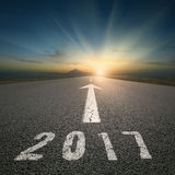 Empty open road to upcoming 2017 at beautiful sunset Stock Image