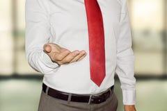 Empty opened hand of businessman Stock Photo