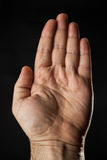Male hand. Empty opened male hand on black background Stock Image