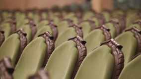 Empty opera concert hall - green chairs without spectators. Wide angle Royalty Free Stock Photography