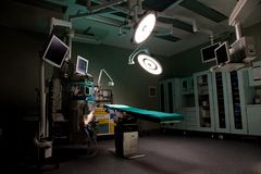 An empty operating room with lights on stock photos