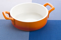 Empty orange bowl and table-cloth Royalty Free Stock Image