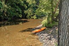 Empty Orange Canoe Stock Photos