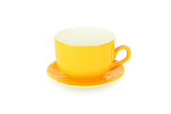 Empty orange cup isolated on white Stock Images