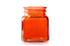Empty orange glass jar Stock Photography