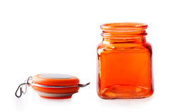 Empty orange glass jar Royalty Free Stock Images