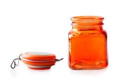 Empty orange glass jar Royalty Free Stock Images