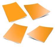 Empty orange magazine on white Stock Images