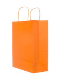 Empty orange paper bag isolated on white Stock Images