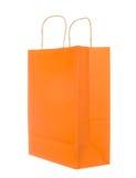 Empty orange paper bag isolated on white Stock Images