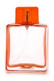 Empty orange perfume bottle isolated Stock Photography