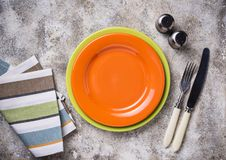 Empty plate on concrete table. Empty orange plate on concrete table royalty free stock image