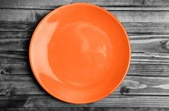 Empty orange plate Royalty Free Stock Photo