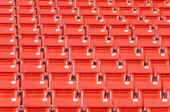 Empty orange seats at stadium Royalty Free Stock Photography