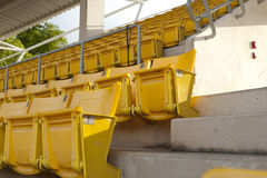 Empty orange stadium seat Stock Photos