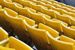 Empty orange stadium seat Stock Photo